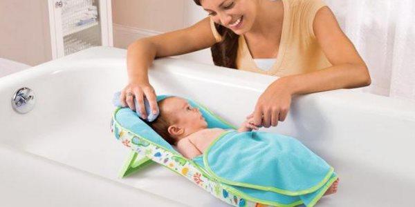 Горка для купания новорожденных: виды, правила выбора и эксплуатации